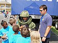 US Navy 080722-N-2888Q-009 Explosive Ordnance Technician Mike Smoot, right, oversees a young girl wearing an EOD 9 bomb disposal suit during Healthy Kids Day at the Delaware State Fair.jpg