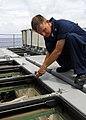 US Navy 080724-N-4236E-114 Gunner's Mate 1st class Robert Lambert performs maintenance on the missile deck.jpg