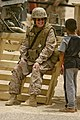 US Navy 080731-M-4937G-104 Religious Program Specialist 1st Class Brenda Dwiggins smiles to an Iraqi boy in Anbar Province, Iraq.jpg