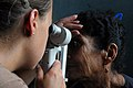 US Navy 080812-N-9774H-117 U.S. Navy Lt. Meagan Rieman, a Navy augmentee working as an optometrist aboard the amphibious assault ship USS Kearsarge (LHD 3), conducts an eye exam on a patient.jpg