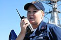 US Navy 081016-N-1831S-025 Cryptologic Technician Technical 2nd class Marie E. Shirk calls in a small watercraft approaching the guided-missile destroyer USS Gonzalez (DDG 66).jpg