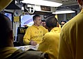 US Navy 081018-N-6676S-003 Lt. Ronald Rancourt, flight deck officer aboard the aircraft carrier USS Theodore Roosevelt (CVN 71), discusses the day's flight operations with aircraft handlers in Flight Deck Control.jpg