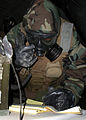 US Navy 081114-N-8547M-041 Yeoman 2nd Class Brandon Clark takes a message on a tactical field message book.jpg