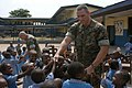 US Navy 090322-M-0378P-101 Cpl. Michael Connor, a Marine Advisor Team member assigned to Africa Partnership Station Nashville, interacts with the children at Western Naval Command Primary School during their lunch break.jpg
