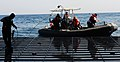US Navy 090829-N-5214S-078 Sailors aboard a rigid hull inflatable boat return to the well deck of the multi-purpose amphibious assault ship USS Bataan (LHD 5).jpg