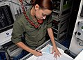 US Navy 091123-N-5148B-026 Quartermaster 2nd Class Janice Carmenattycharon, from Maricao, Puerto Rico, plots navigation charts aboard Landing Craft Utility (LCU) 1665.jpg