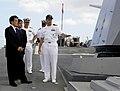 US Navy 100111-N-7498L-022 Cmdr. Mike McCartney gives a tour of the ship's forecastle to Katsuya Okada.jpg