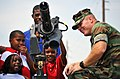 US Navy 100508-N-7367K-004 Children visit a static display of an M-134D Gatling Gun during Seabee Day at Naval Construction Battalion Center, Gulfport.jpg