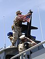US Navy 100526-N-8824M-030 Sailors assigned to Maritime Security Squadron (MSRON) 9 perform colors aboard a 34-foot patrol boat before launching the craft into San Diego Bay for a training exercise.jpg