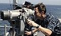 US Navy 100719-N-0864H-348 Vice Adm. John M. Bird, commander of U.S. 7th Fleet, looks through the.jpg