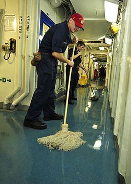 US Navy 100803-N-0569K-029 Electrician's Mate Fireman Apprentice Brian J. Stuart and Electrician's Mate 3rd Class Katrina L. White swab a passageway aboard the aircraft carrier USS Enterprise (CVN 65)
