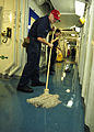 US Navy 100803-N-0569K-029 Electrician's Mate Fireman Apprentice Brian J. Stuart and Electrician's Mate 3rd Class Katrina L. White swab a passageway aboard the aircraft carrier USS Enterprise (CVN 65).jpg