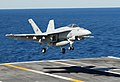 US Navy 101023-N-2686K-585 An F-A-18E Super Hornet assigned to Strike Fighter Squadron (VFA) 87 lands aboard the aircraft carrier USS George H.W. B.jpg