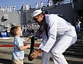 US Navy 101214-N-7498L-198 Boatswain's Mate 1st Class Frank Mortensen greets his son on the pier after returning to Joint Base Pearl Harbor-Hickam.jpg
