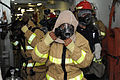 US Navy 110121-N-5592W-010 Fire party members aboard the amphibious assault ship USS Makin Island (LHD 8) dress out in firefighting ensemble during.jpg