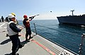 US Navy 110514-N-TB177-141 A Sailor aboard the guided-missile destroyer USS Truxtun (DDG 103) fires the messenger line.jpg