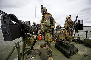 US Navy 111207-N-PC102-050 Sailors aboard Riverine Command Boat 803, assigned to Riverine Squadron (RIVRON) 1, man their positions as gunners while.jpg