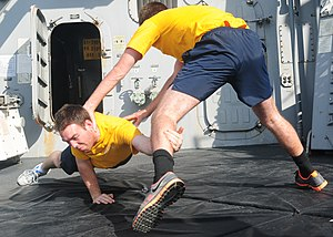 US Navy 120105-N-ZF681-229 Sailors aboard the guided-missile destroyer USS Halsey (DDG 97) practice takedown techniques during crowd control tactic.jpg