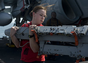 US Navy 120112-N-JN664-081 Aviation Ordnanceman 3rd Class Alecia Crockett moves a BRU-41 multiple ejector rack on the flight deck of the Nimitz-cla.jpg