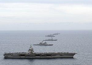 US Navy 120123-N-JL826-045 Ships from the Enterprise Carrier Strike Group maneuver into formation.jpg
