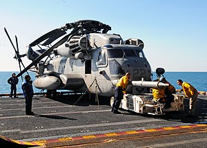 US Navy 120130-N-ZZ999-161 Sailors aboard the multipurpose amphibious assault ship USS Iwo Jima (LHD 7) prepare to move a HSC-22 Sea Knight helicop.jpg