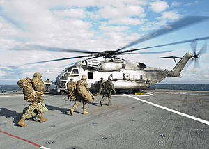US Navy 120202-N-NR955-089 Marines assigned to the 24th Marine Expeditionary Unit (24th MEU) prepare to board a CH-53E Super Stallion helicopter as.jpg