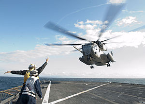 US Navy 120202-N-NR955-141 Sailors guide a CH-53E Super Stallion helicopter assigned to Marine Heavy Helicopter Squadron (HMH) 464 during a simulat.jpg