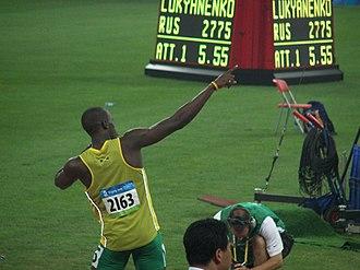 "Usain Bolt - Bolt doing the ""Lightning Bolt"" just before breaking the 200 m world record in the Beijing National Stadium."