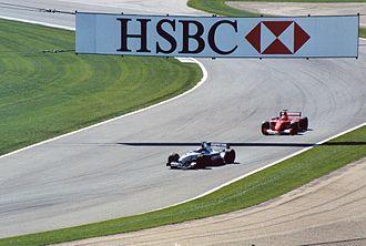 2001 United States Grand Prix - Juan Pablo Montoya leads Michael Schumacher through the infield section during the 2001 United States Grand Prix