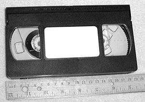 """David Herbert (artist) - A VHS tape cassette 7½"""" long of the type replicated by Herbert in a 96"""" sculpture, VHS."""
