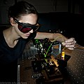 Visiting student with illuminated fibre in fluorescence vial - Institute for Photonics and Advanced Sensing (IPAS) - University of Adelaide.jpg