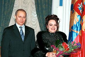 Zolotoe Koltso - Leading singer of the band, Nadezhda Kadysheva, receiving People's Artist of Russia title from Vladimir Putin