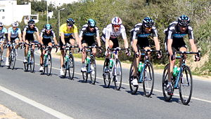 Peloton - Team Sky riding in a straight line to increase slipstreaming, thus reducing drag and conserving energy for cyclists behind, often for key riders such as sprinters or GC cyclists.