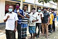 Voters standing in the queue to cast their votes, at a polling booth, during the third phase of the West Bengal Assembly Election, in Uluberia, West Bengal on April 06, 2021.jpg
