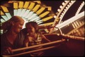"WANDA SHEMWELL AND HER DAUGHTER SUSAN (9) RIDE ON THE TRABANT, A GERMAN AMUSEMENT RIDE AT ""FUN CITY"" ON ""THE STRIP.""... - NARA - 551299.tif"