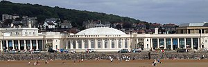 White building behind the beach. It has a dome and colonnades to left and right.