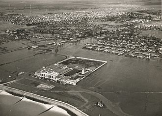 Canvey Island - The flooded sea front, amusements and residential areas in 1953