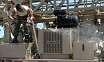Well drillers clean equipment 150808-F-LP903-0723.jpg
