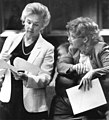 Women legislators perusing proposed legislation during session.jpg