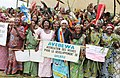 Women with banners welcome Guests in Waliakle (6129380829).jpg