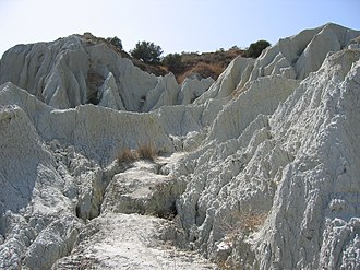 Xi Beach - The cliffs are composed of a soft, white clay which has been eroded by the rain