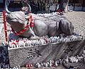 Yamada Ten'man-gû Shintô Shrine - Stone statue of a cattle lying down.jpg