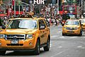Yellow Cabs at Times Square (5896303294).jpg
