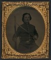 (Unidentified soldier in Union frock coat and SNY (State of New York) belt buckle with musket, sword bayonet, and revolver) LOC 5229207960.jpg