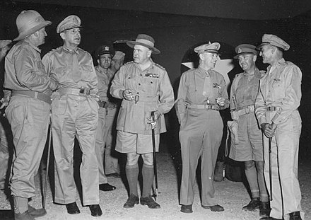 Senior Allied commanders in New Guinea in October 1942. Left to right: Mr Frank Forde (Australian Minister for the Army); MacArthur; General Sir Thomas Blamey, Allied Land Forces; Lieutenant General George C. Kenney, Allied Air Forces; Lieutenant General Edmund Herring, New Guinea Force; Brigadier General Kenneth Walker, V Bomber Command. 03 walker macarthur.jpg