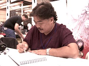 Penciller - Artist Whilce Portacio sketching at a convention