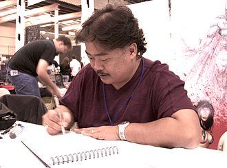 Penciller - Artist Whilce Portacio sketching at a convention