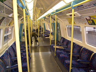 """London Underground 1996 Stock - Interior showing the """"Tube Lines"""" moquette introduced in 2005"""