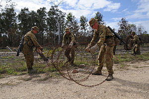 1st Combat Engineer Regiment (Australia) - Members of 1 CER laying down barbed wire obstacles during Exercise Talisman Sabre 2009