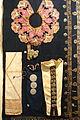 1 Robe collar with unicorn, Tay, 2 Silver bra inlays, Dao Tien, 3 Silver dress inlays, Thai, 5 Turban ornaments, Cham Hroi, 6 Shawl, Lo Lo - Vietnam National Museum of Fine Arts - Hanoi, Vietnam - DSC05236.JPG